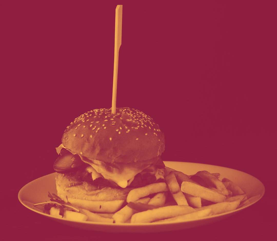 Hamburger on plate in red duotone