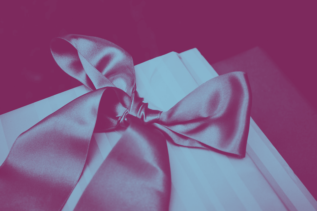 Close up of gift wrapped with silk ribbon